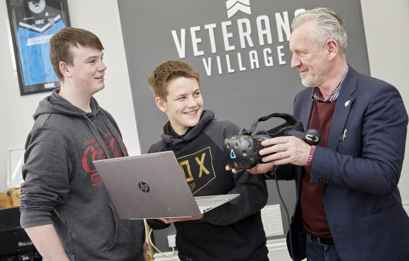 Students learn tech skills to bring Veterans Village to life image