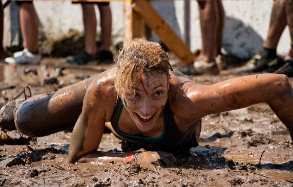 Volunteer group supports muddy Dove House challenge image