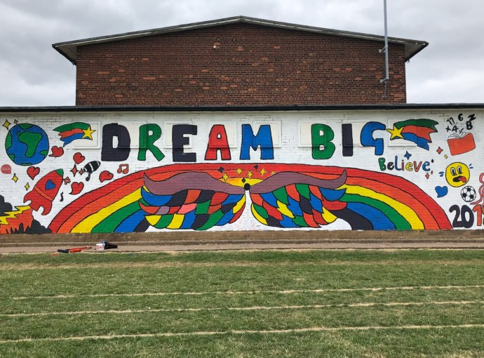 Primary pupils leave behind inspiring mural feature image